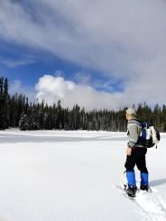 Snowshoer approaching frozen Deer Lake © Craig Romano