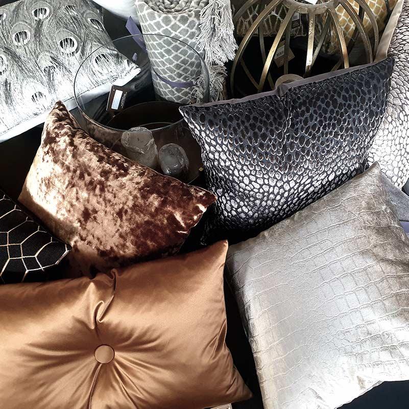 Claudi kussens, plaids en beddengoed