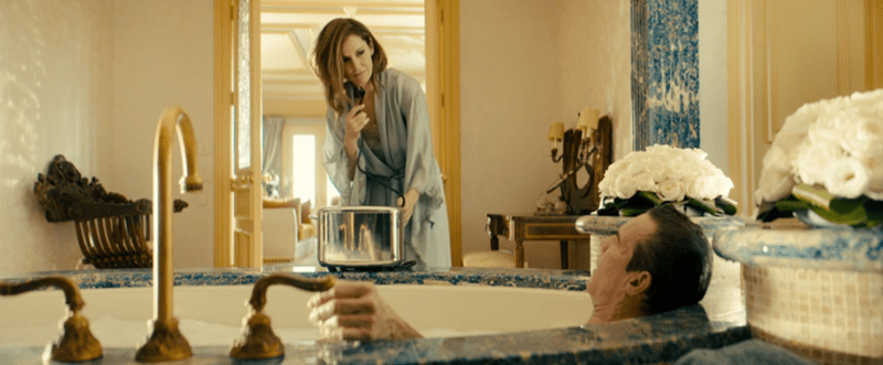 Goliath Season 3: The weird and the wonderful. Wade Blackwood (Dennis Quaid) in an almond milk bath, as his sister Diane (Amy Brenneman) plugs a toaster into the bath socket, part of their dangerous and complicated relationship game.