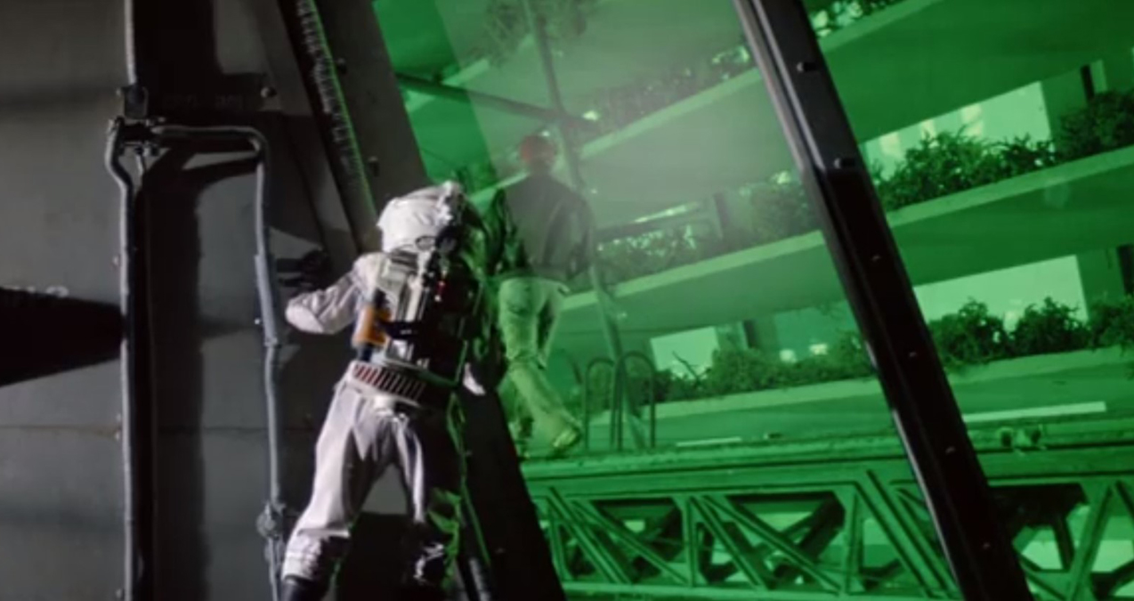 Astronaut outside greenhouse in Outland (1981)