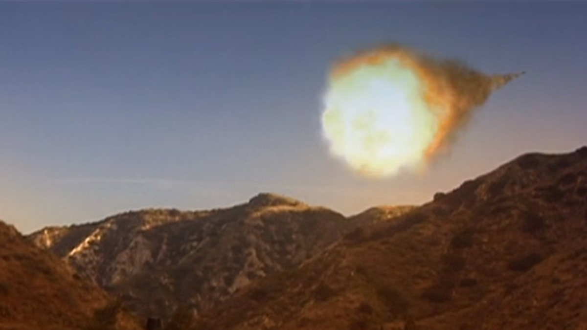 Scene showing massive incoming meteor over desert mountains in film Total Eclipse (2008)