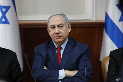 FILE - Israeli Prime Minister Benjamin Netanyahu chairs the weekly cabinet meeting in Jerusalem, Jan. 5, 2020. (Ronen Zvulun/Pool via AP)