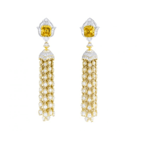 Precious Light Earrings. It is extremely rare to find two yellow diamonds with such a unique color. Set on Precious Light earrings, these two yellow diamonds weighing a total of 9.04 carats are shown off to advantage by their emerald-cut and the white diamonds that surround them. I love that the tassels are detachable for versatility sake!
