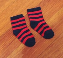 Red/Navy socks (Dominic always wear a whimsical pair of socks)