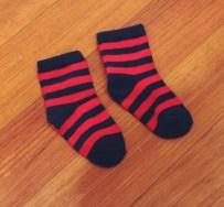 Red/Navy socks (Dominic always wear a whimsical pair of socks)