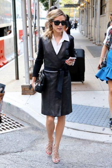 Fashion blogger Olivia Palermo, wearing a leather coat dress, leaves Diane von Furstenberg at Spring Studios