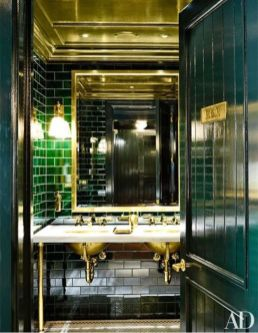The use of green subway tile is both masculine and timeless in the boldest way.