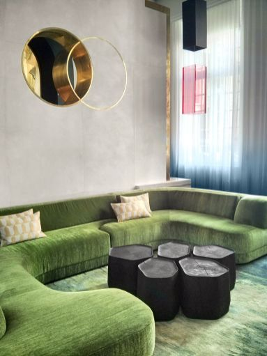 This modern sectional in the perfect shade of green is great with the geometric cocktail table.