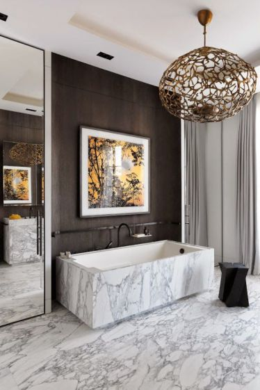 This contemporary piece by Herve Van der Straeten from the Ralph Rucci showroom looks incredible in the stark white bathroom, adding another layer of luxury to the space.
