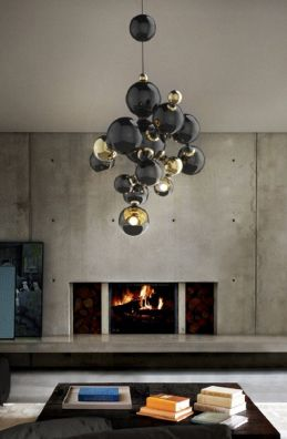 This molecular-inspired chandelier in black and gold is perfect in this very contemporary, avant-garde room. The piece would look extremely dramatic in a circular staircase or grand foyer with high ceilings.