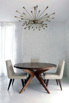 The classic Sputnik chandelier is the star of this otherwise clean contemporary eat-in kitchen.