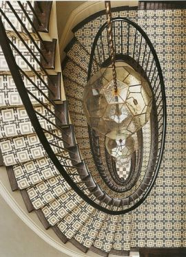 The patterned runner is quite the wild, sophisticated compliment to the three-story chandelier in this Greenwich Village townhouse.