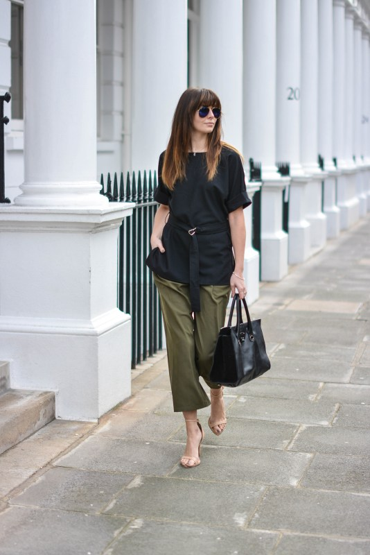 EJSTYLE-Emma-Hill-London-Street-style-SS15-LFW-asos-silky-Khaki-cropped-trousers-Jimmy-Choo-Riley-Bag-ASOS-d-ring-black-t-shirt-top-nude-strappy-sandals-ray-ban-sunglasses-OOTD