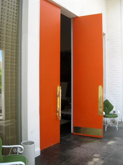 These bold orange lacquered doors create quite the entrance at the Perkerin Palm Springs. We also love orange with brass and avocado! & These bold orange lacquered doors create quite the entrance at the ...