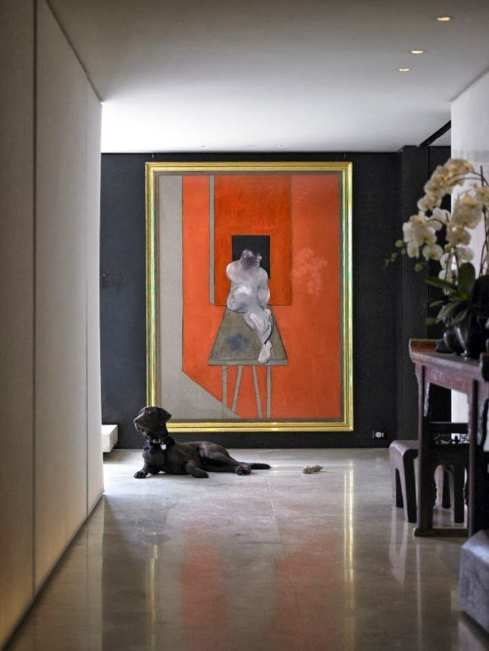 Designer Donna Karan pops orange in a painting in her chic Manhattan apartment