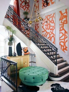 Kelly Wearstler's graffitti wallpaper in orange is quite dramatic in this staircase