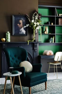 Combining shades and hues of green creates quite a sophisticated and harmonious scheme. The use of warm army green with cool kelly in the bookshelves and a medium teal on the classic wingback chair feels quite fresh.
