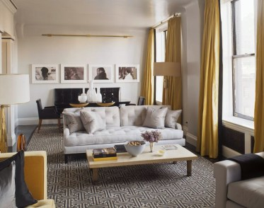This incredibly chic patterned rug is the true statement piece in this subtle room by S. Gambrel.