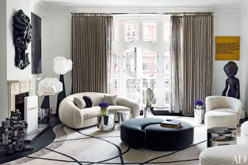 This fantastic, custom avant-garde rug is the perfect compliment to the Kagan-esque sofa with yin and yang ottoman and sculptural, edgy art.