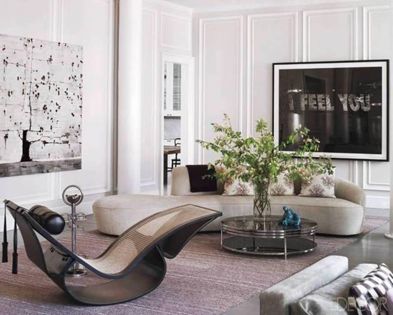 This simple round coffee table is perfect in a room filled with such sculptural objects as the Vladimir Kagan sofa.