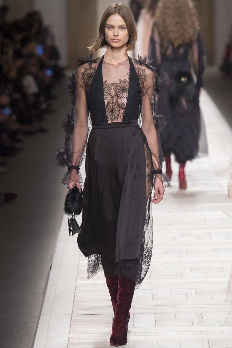 Model walks down runway wearing fendi