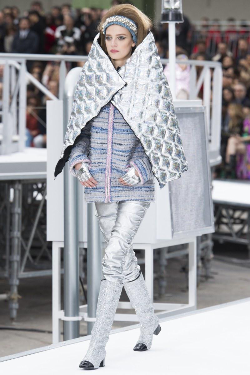 model walks down runway at chanel show