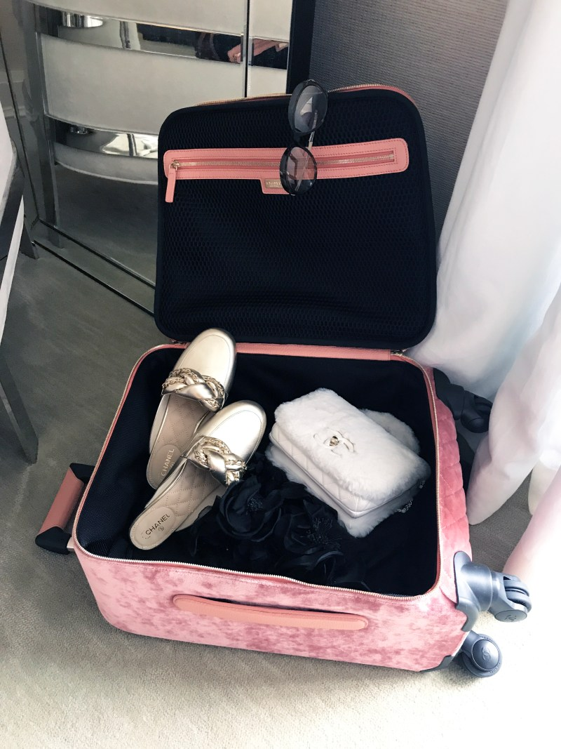 Suitcase full of chanel items at the mark hotel