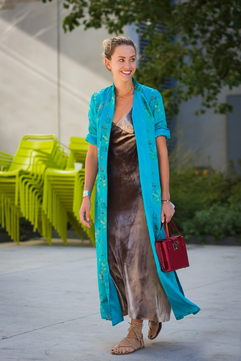 bohemian style type street style blogger wearing short sleeve printed kimono and maxi dress with red mini bag