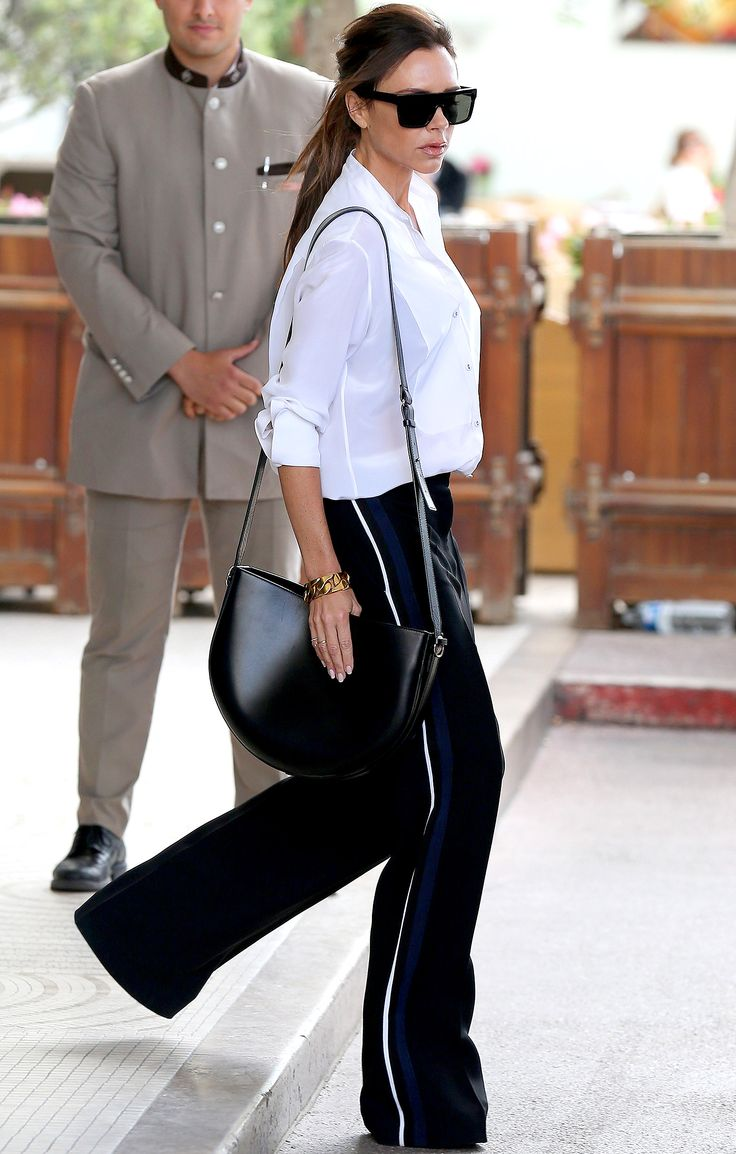 Chic style type street style victoria beckham in white button up and track pants