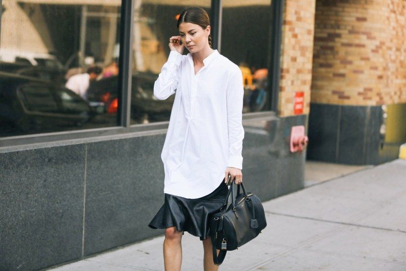 White button down dress with a leather skirt under