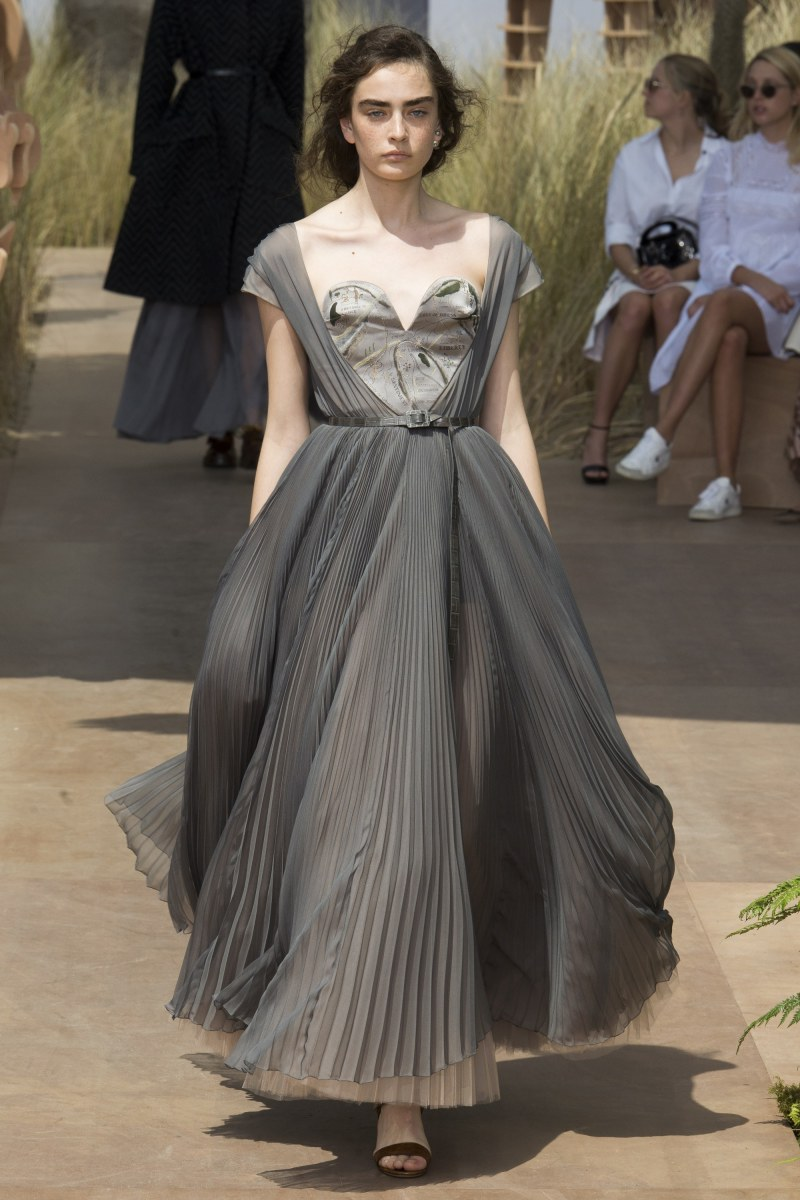 Model in gray dior dress walking down runway at fall 2017 couture show