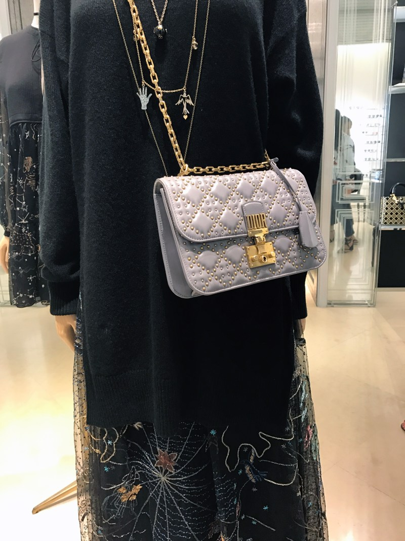 Quilted dior purse on a mannequin with dress