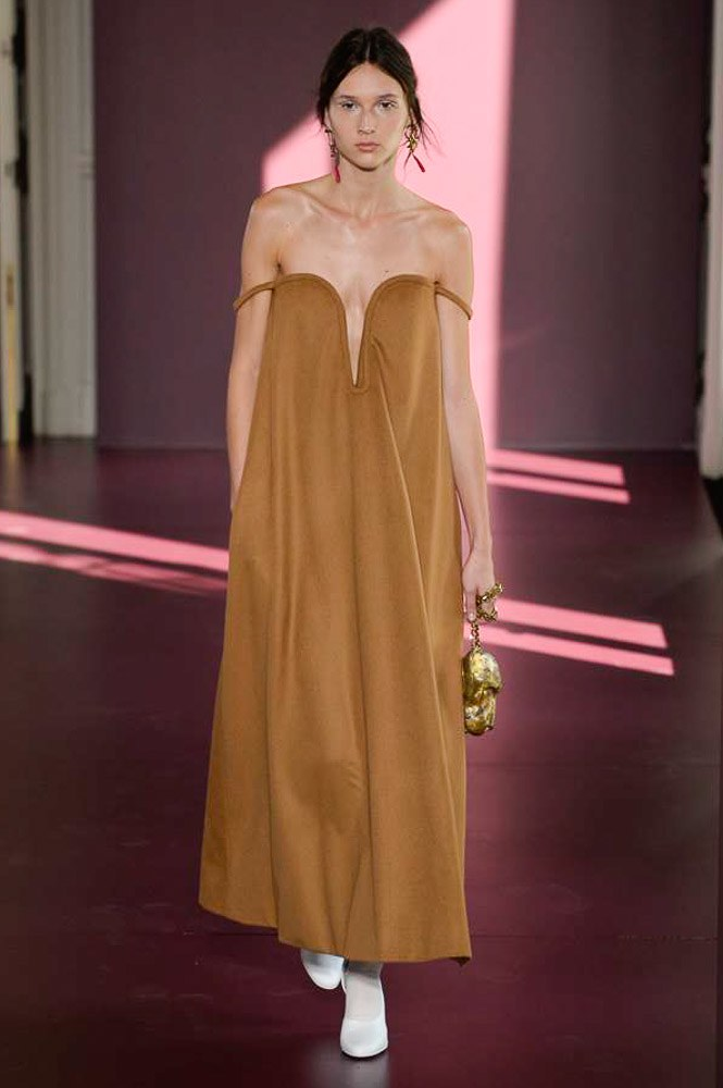 Model walking down runway in blue valentino dress