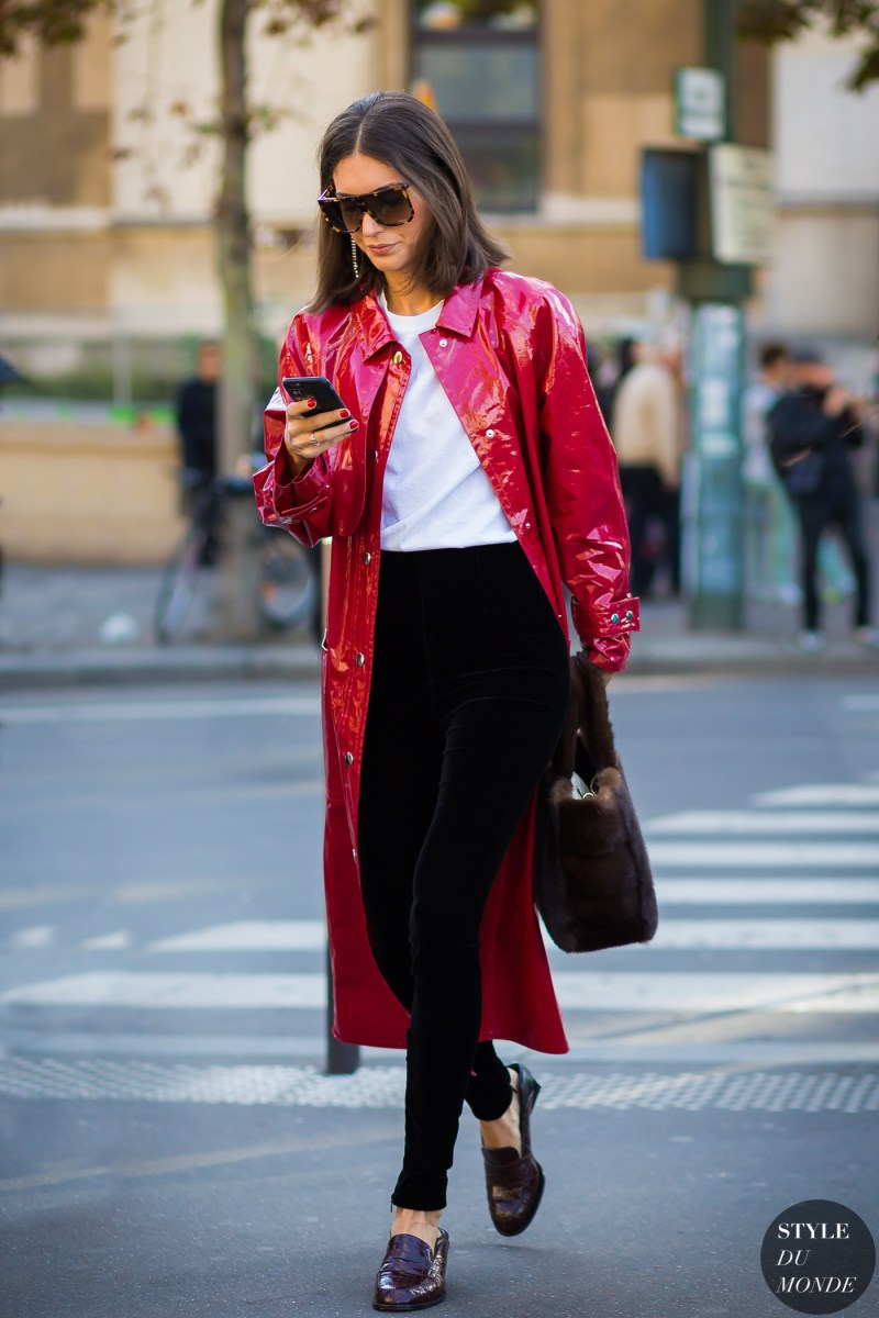 street style shot as blogger wearing red leather trench