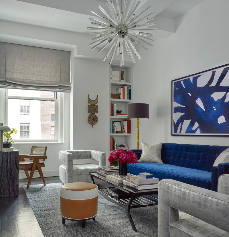 nyc interior designer joe lupos work - cobalt couch, silver sofa chairs, chandelier