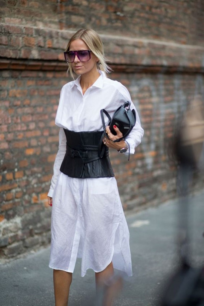 Blogger wearing a white button down dress with a leather corset