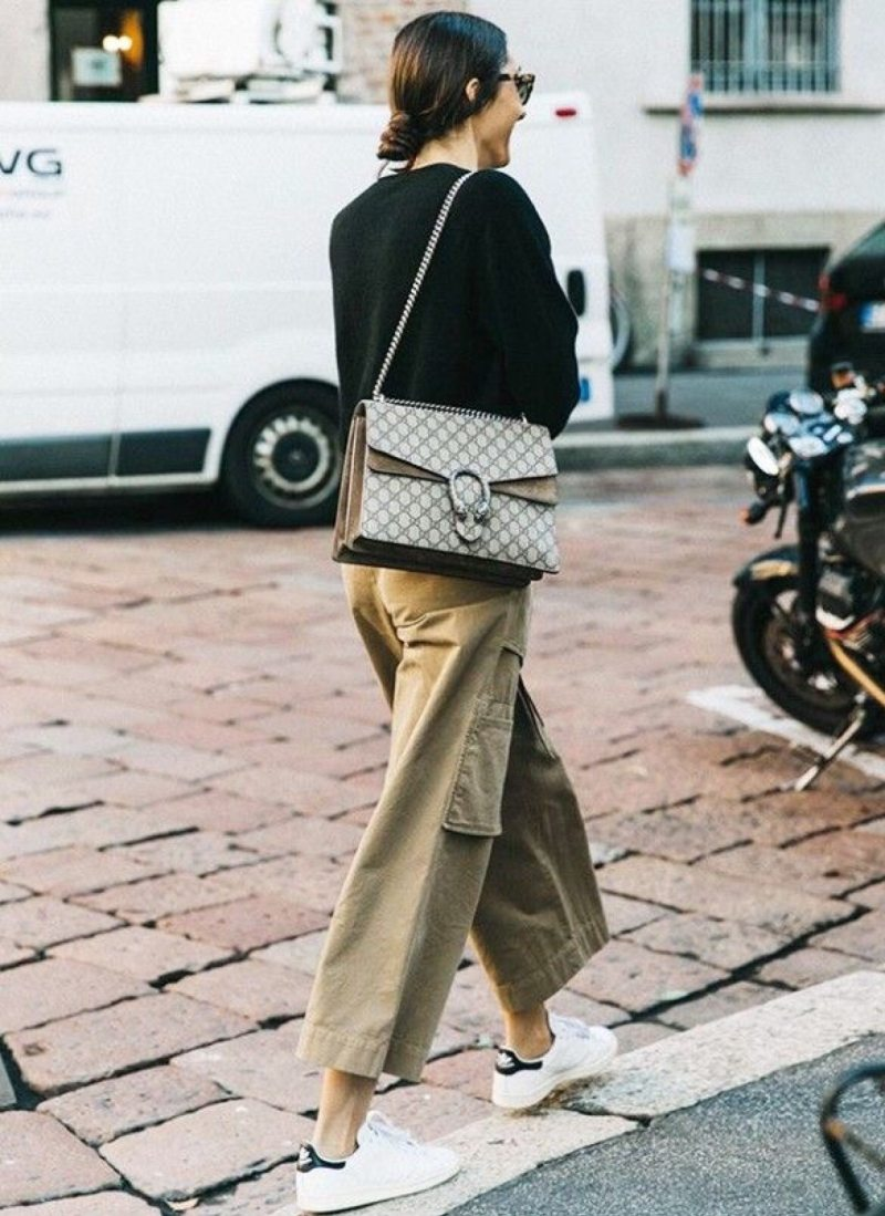Blogger in adidas, cargo pants, black sweater and gucci bag