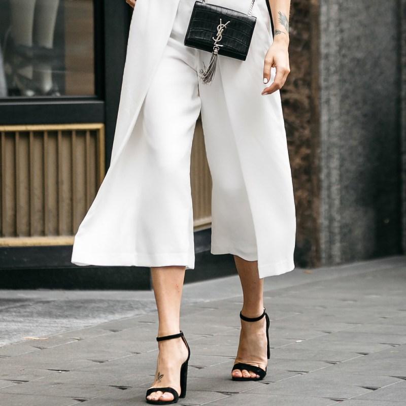 black strap heels, white pants, ysl black bag