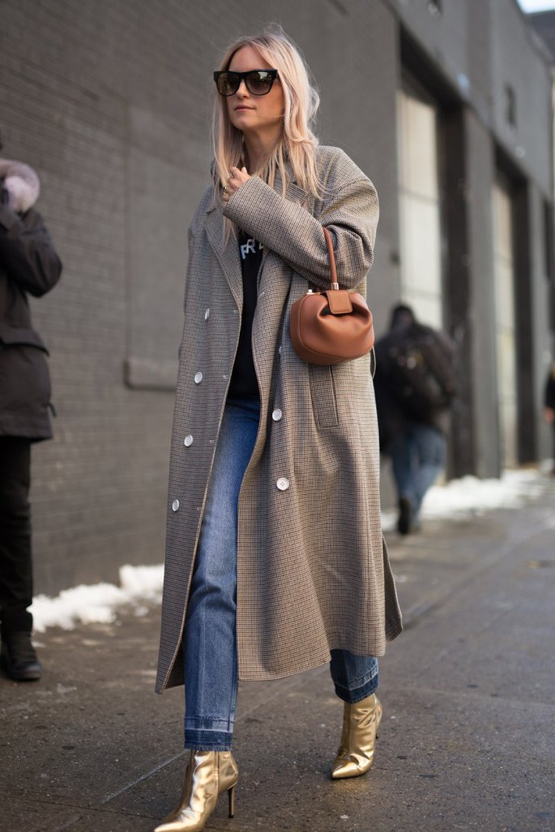 blogger wears gold booties and trench coat