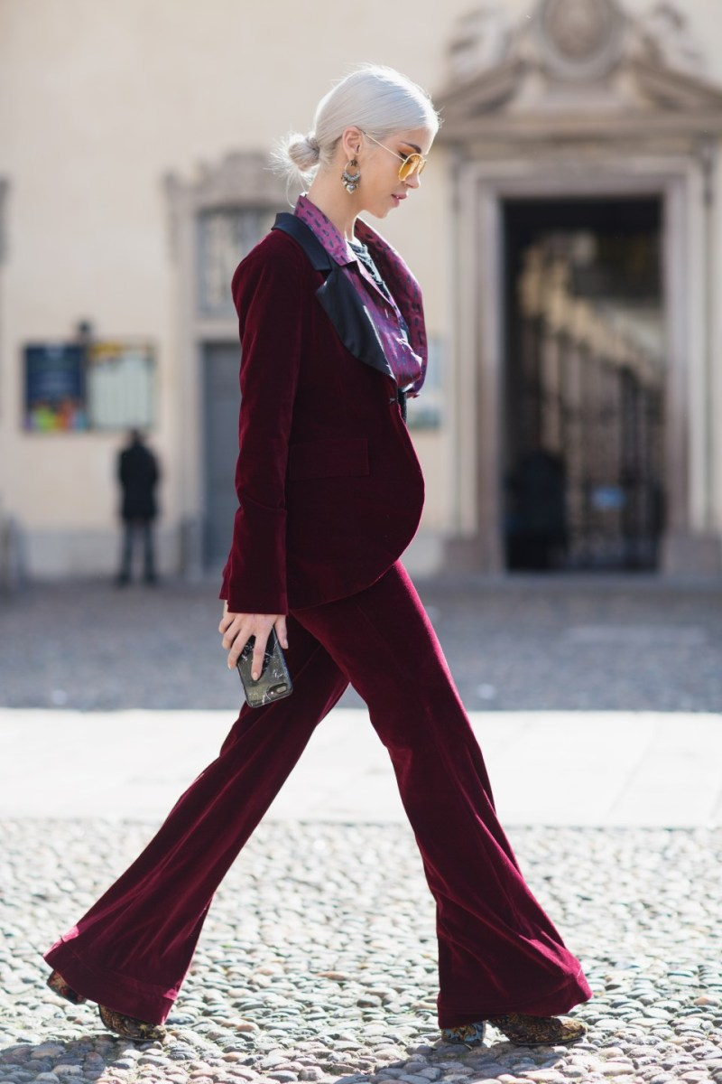 Woman wearing burgundy velvet suit