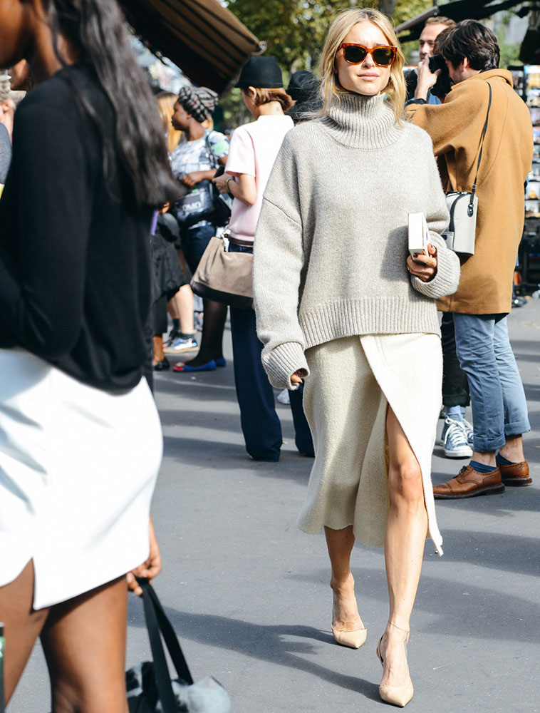 Pernielle in beige knit skirt and gray knit turtle neck