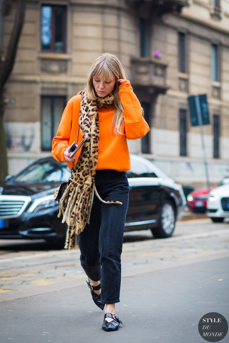 Street style shot of jeanette friis wearing cheetah print scarf