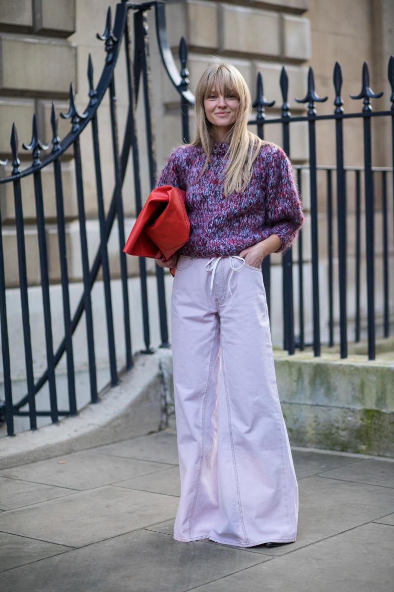 Street style shot of blogger attending london fashion week in purple monochromatic outfit skirt and shirt
