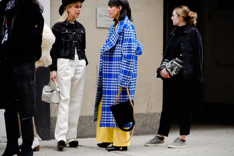 street style shot of bloggers waiting to get into a nyfw show