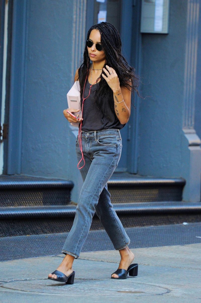Street style shot of zoe kravits wearing mules, jeans and a tank top