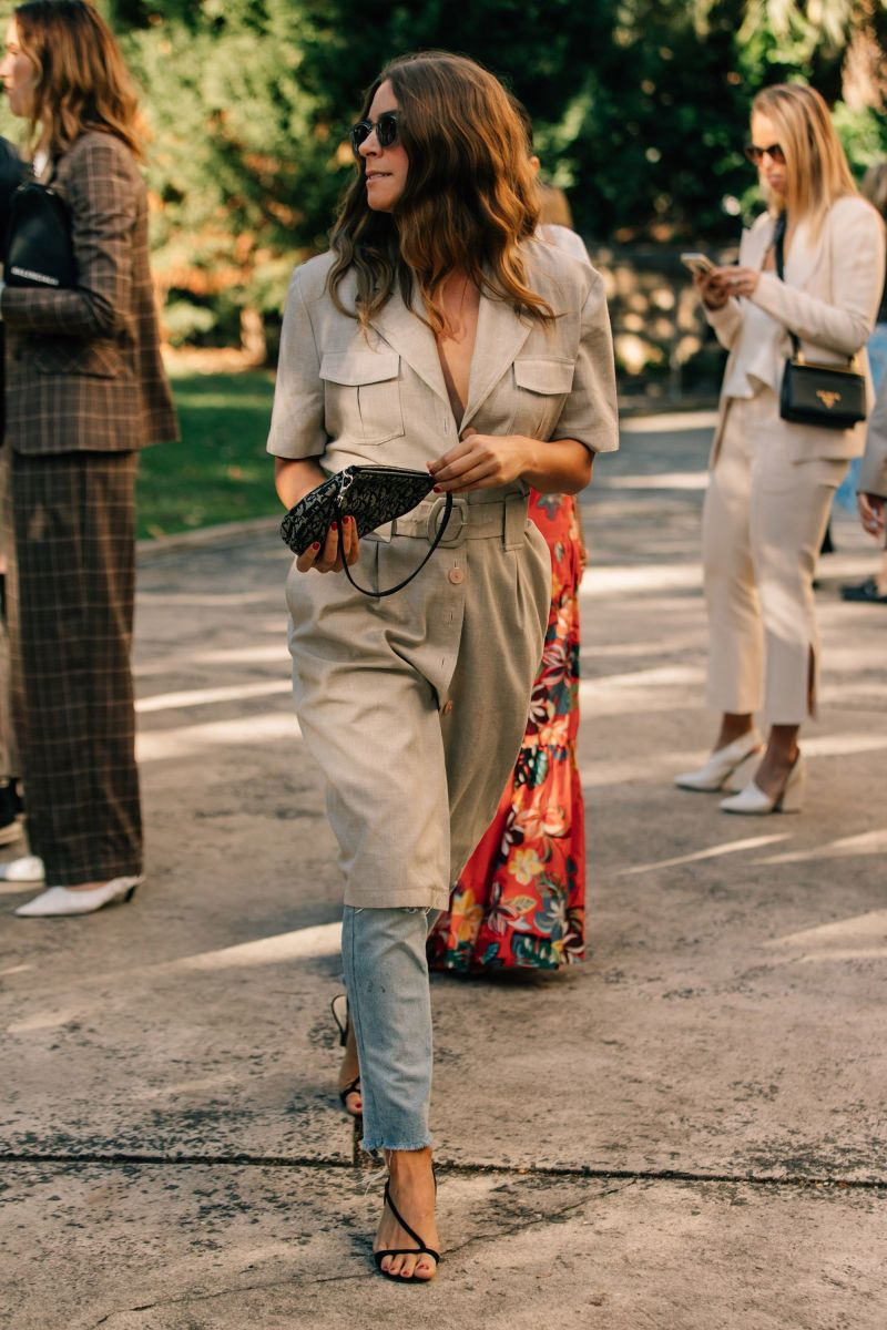 Street style shot of girl wearing blue jeans, black sandals and khaki dress