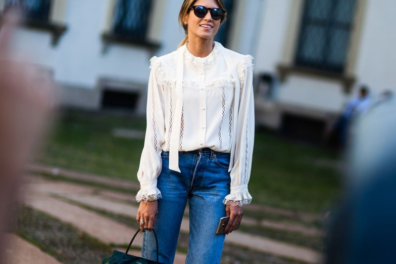 Girl in white romantic shirt and jeans
