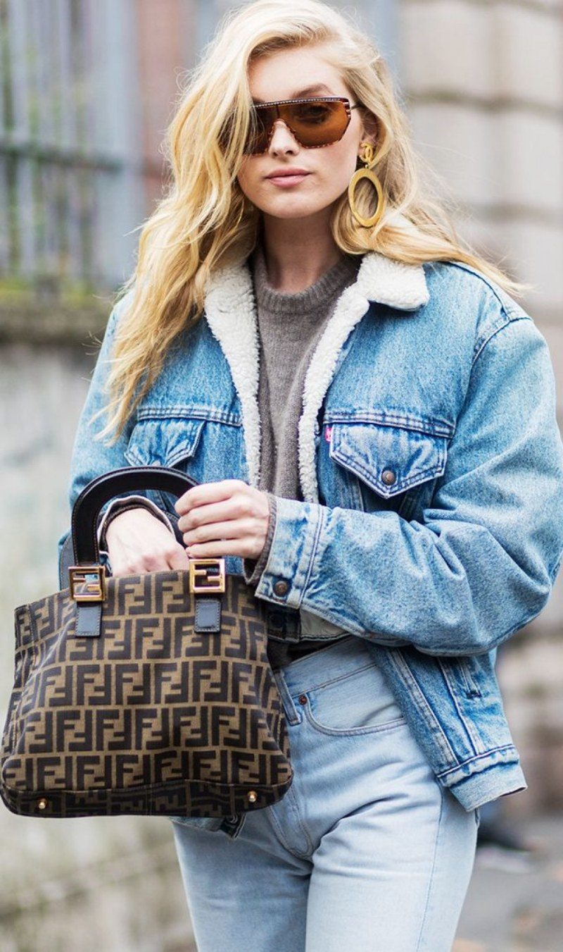 street style shot of blogger wearing denim jacket and fendi bag
