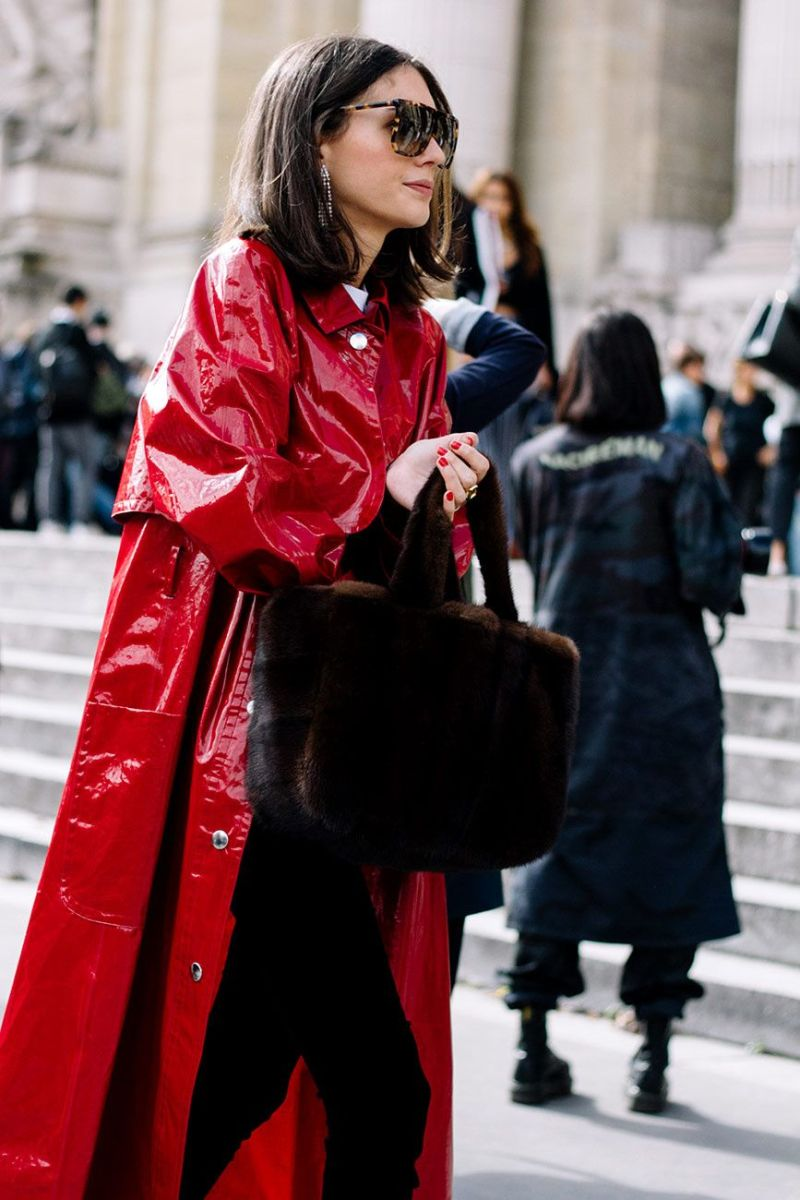 Diletta Bonaituti seen crossing the street in a loewe fur bag, red patent trench, black pants and white tee.