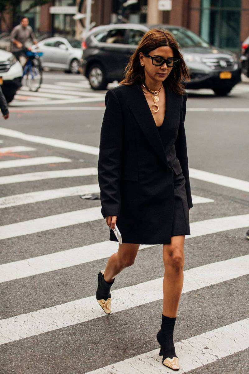 Street style shot of Christine wearing cowboy boots at nyfw